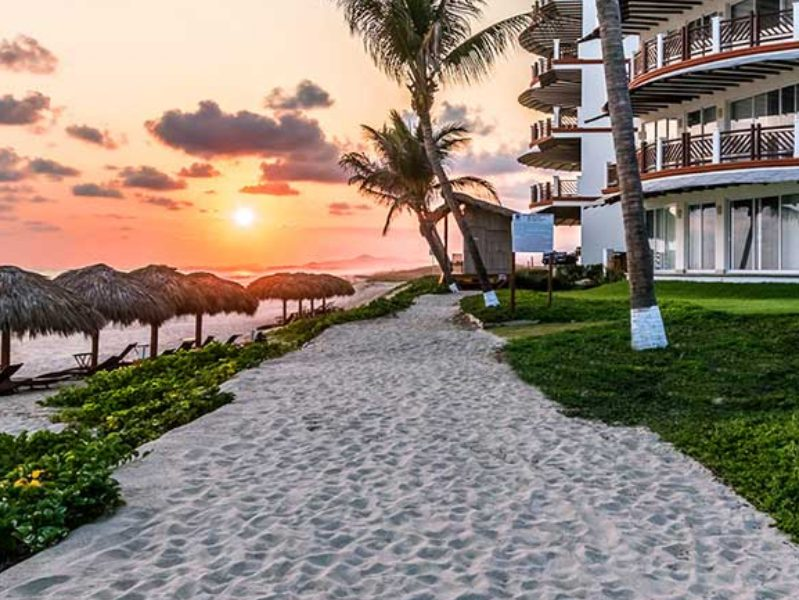 View of the path along Palmarito Beach in front of Vivo Resorts in Puerto Escondido MX