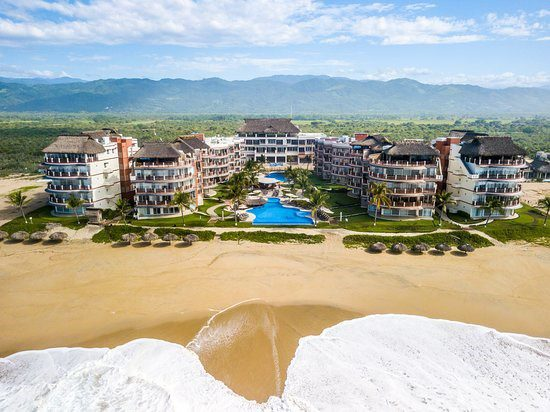 Aerial view of Vivo Resorts complex in Puerto Escondido MX - taken from over the ocean