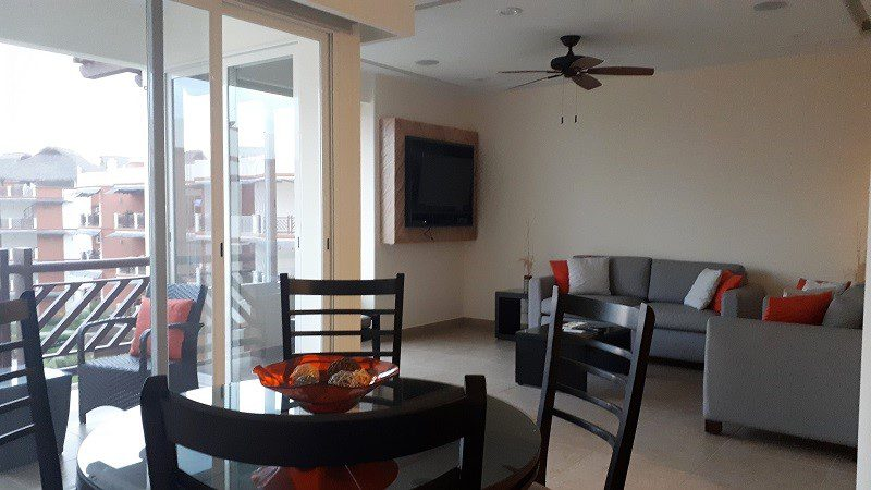 Typical condo dining and living area at Vivo Resorts